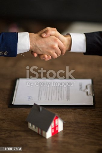 828544458istockphoto Purchase agreement for new house 1126517323