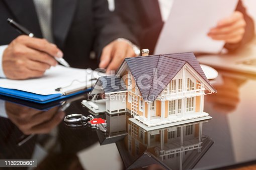 828544458istockphoto Purchase agreement for new house 1132205601