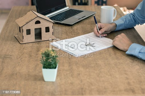 475902363 istock photo Purchase agreement for new house 1161723085