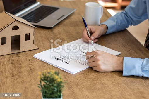475902363 istock photo Purchase agreement for new house 1161723090