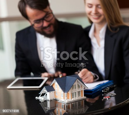 828544458istockphoto Purchase agreement for new house 900741938