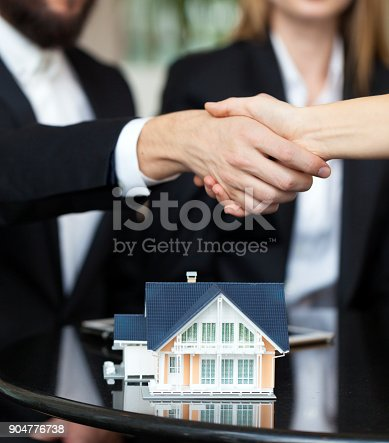 828544458istockphoto Purchase agreement for new house 904776738