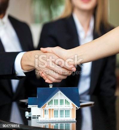 828544458istockphoto Purchase agreement for new house 904776914