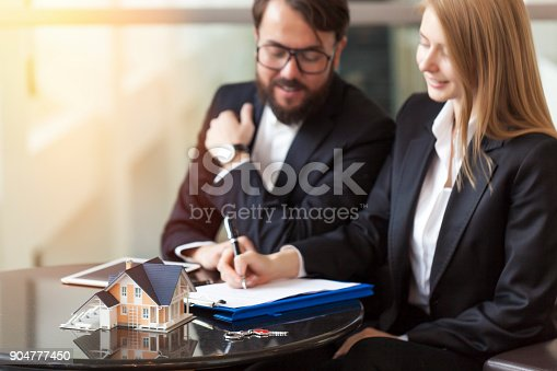 475902405istockphoto Purchase agreement for new house 904777450