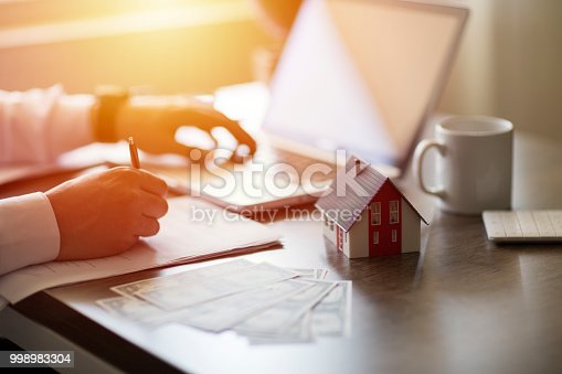 828544458istockphoto Purchase agreement for new house 998983304
