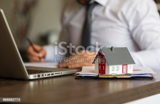 828544458istockphoto Purchase agreement for new house 998983774