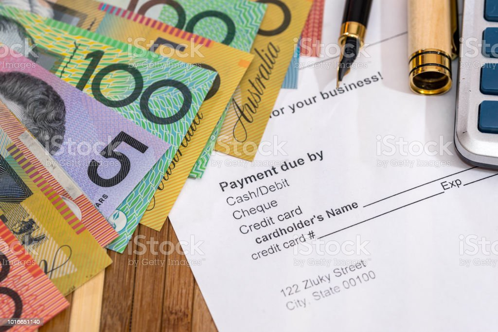 Purchase order with australian dollars and pen on table stock photo