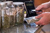 Purchasing legal marijuana at a local dispensary using my card as a method of contactless payment.