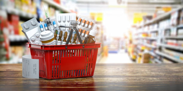 Purchasing medicines in  pharmacy drugstore. Shopping basket full of medicines, pills and blisters. stock photo