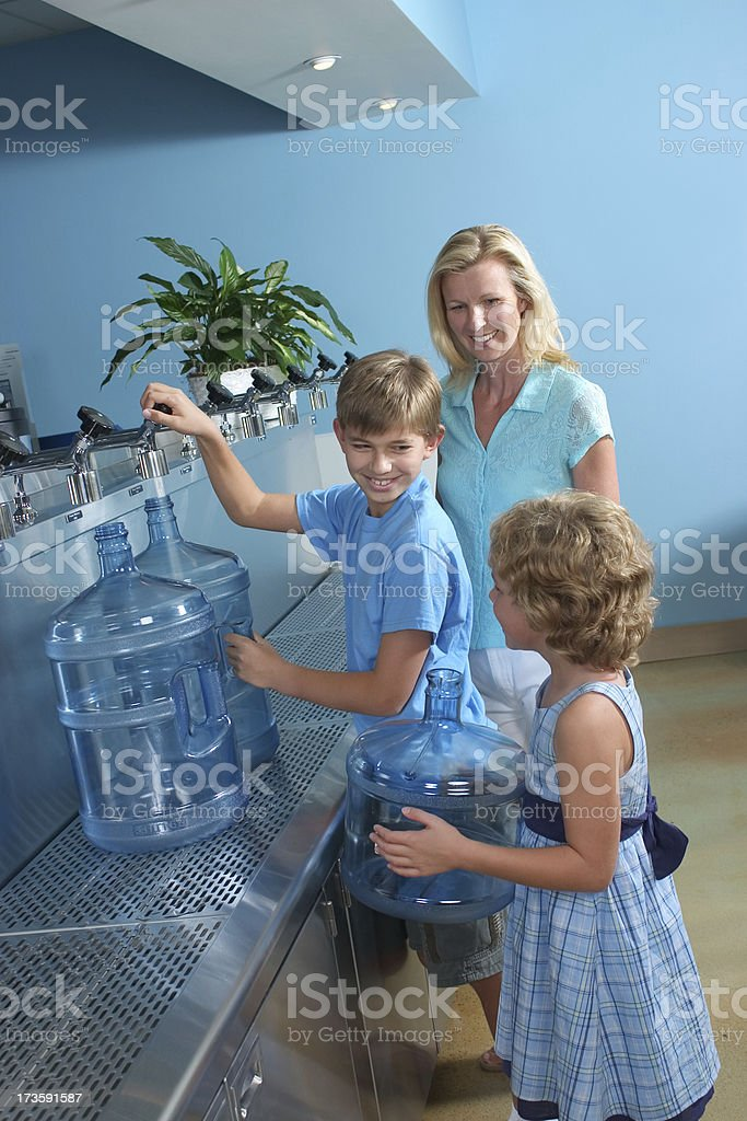 Purchasing Purified Water royalty-free stock photo