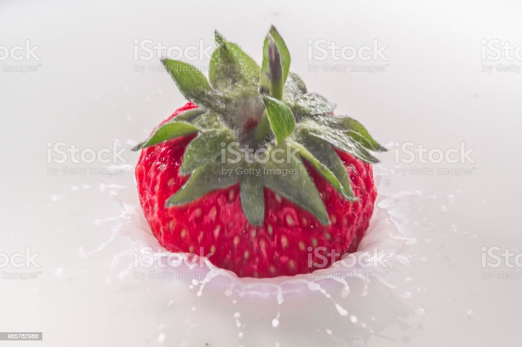 pure falling strawberry into milk with splash - Royalty-free Berry Stock Photo