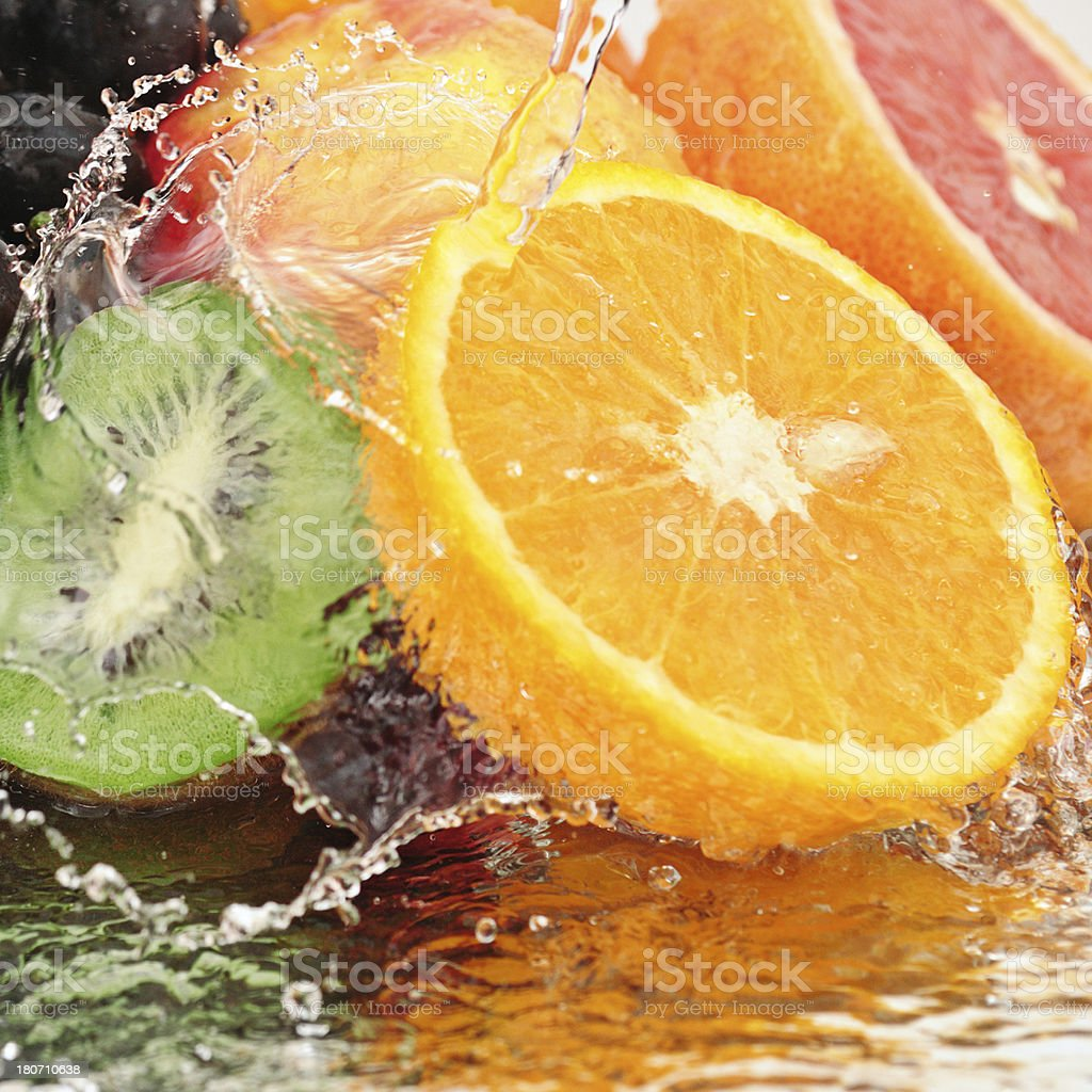 Pure fruit in a spray of water stock photo
