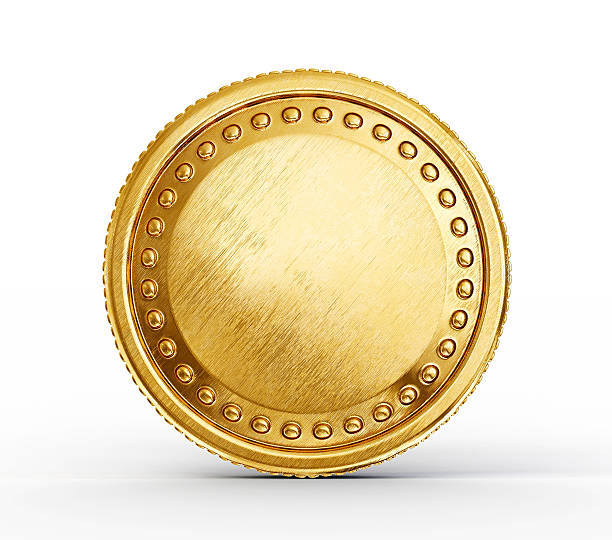 a pure gold coin with raises dots in a circle in it - coin stock photos and pictures