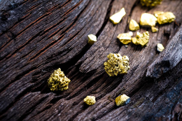 pure gold ore on old wooden rails - gold mine stock photos and pictures