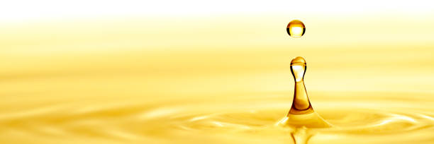 Pure Golden Oil Pure Golden Oil Splashing Into Puddle biodiesel stock pictures, royalty-free photos & images