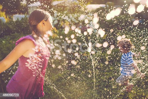 Little boy and girl playing with water