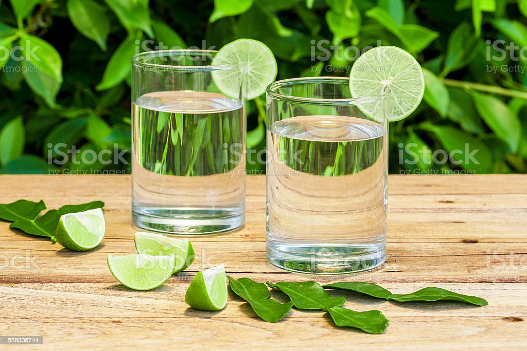 Pure healthy water with lime in small glasses stock photo