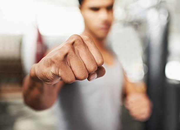 pure power - fist stock photos and pictures