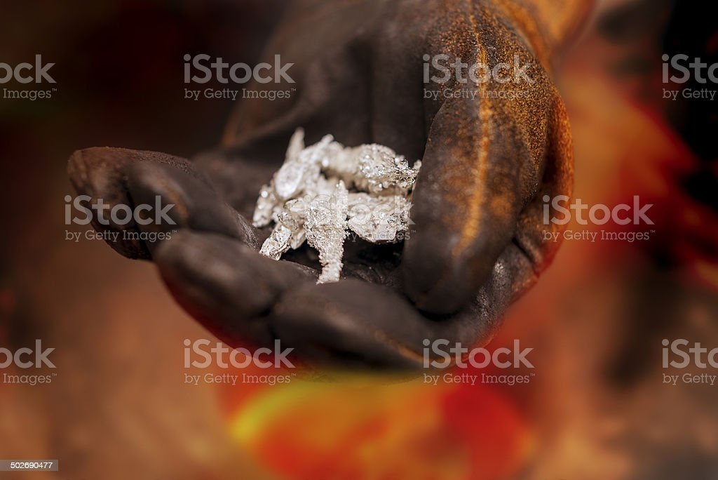 Pure silver crystals with glove royalty-free stock photo