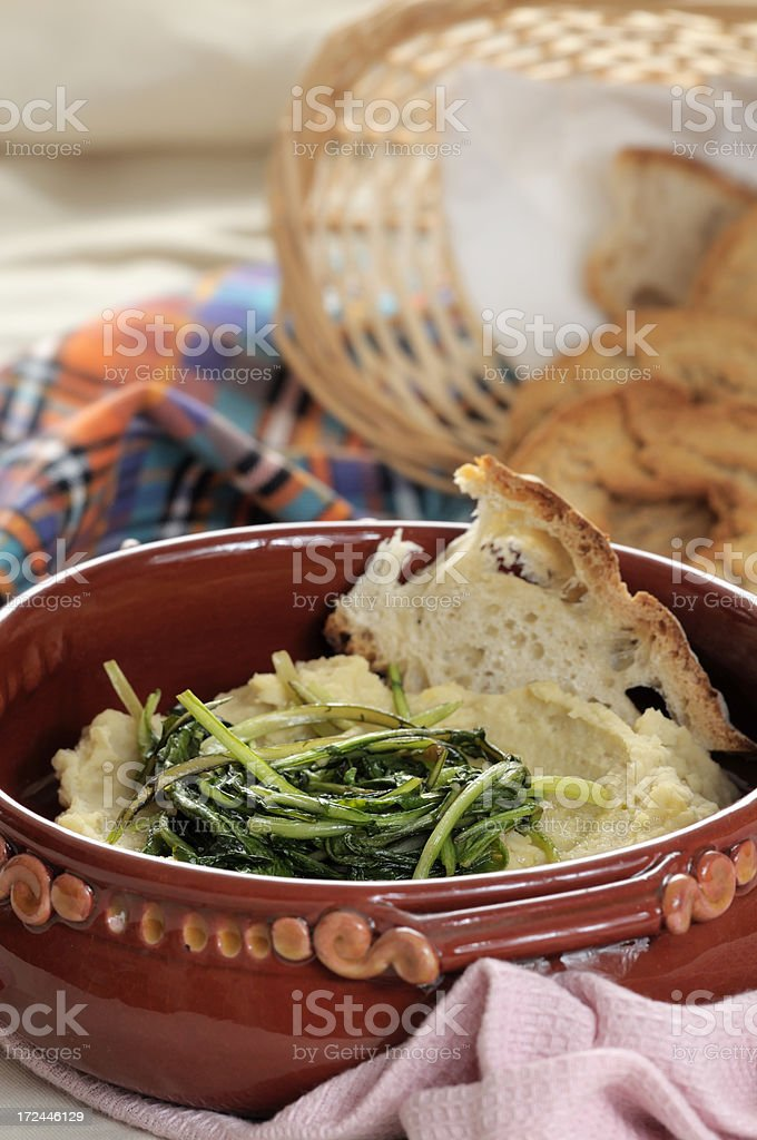 Pureed dried beans with wild chicory royalty-free stock photo