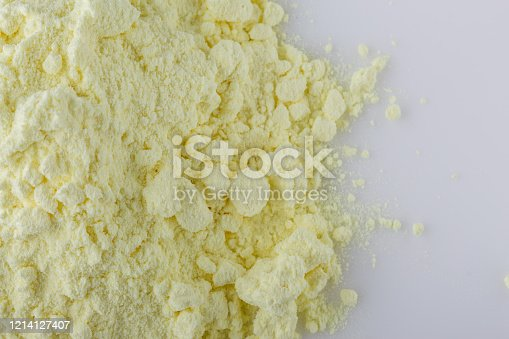 purified sulfur powder on a white acrylic background.