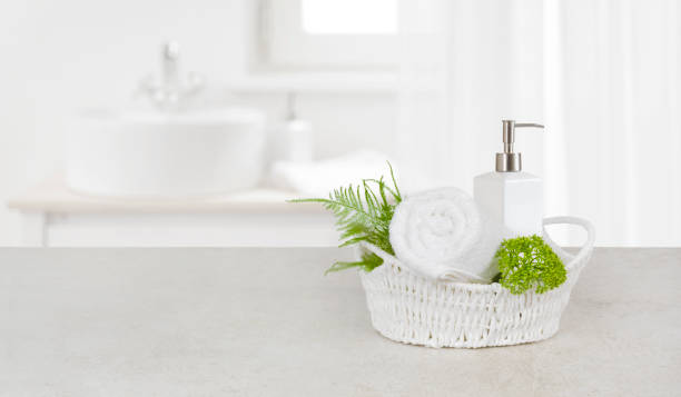 Purity concept with decorated bathroom accessories on stone table stock photo