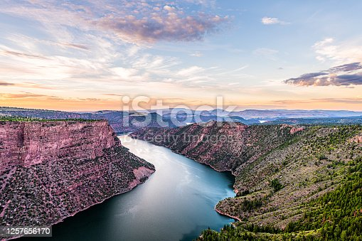 Purple aerial above view from Canyon Rim trail overlook near campground in Flaming Gorge Utah National Park with Green River at sunset twilight evening