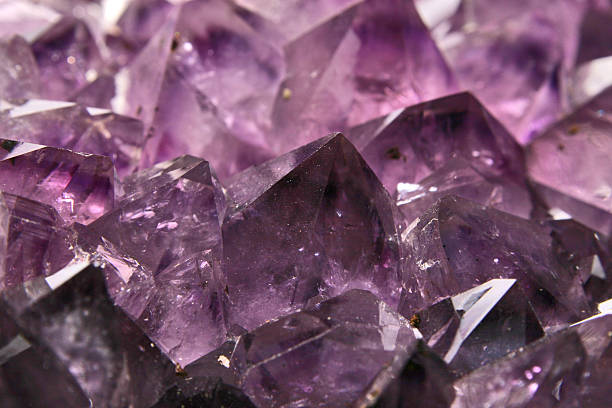 A purple amethyst crystal close-up stock photo