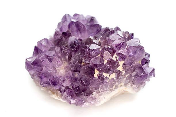 Purple amethyst stone isolated on white stock photo