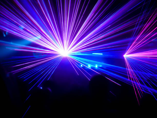 purple and blue club lasers - disco lights stock photos and pictures