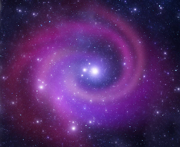 Purple and blue spiral galaxy swirling in space stock photo