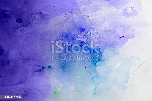 istock Purple and blue wet watercolor background on a white paper 1156344786