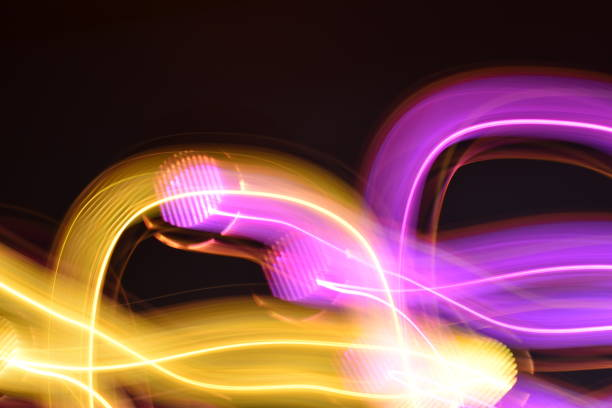 purple and gold light grid trails - steven harrie stock photos and pictures