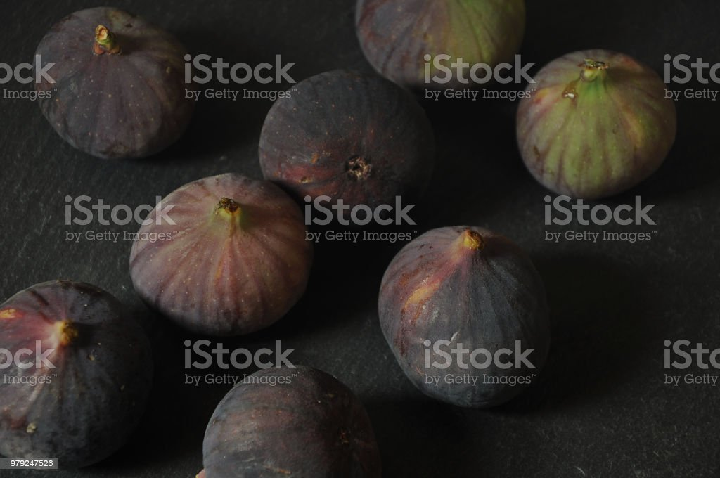 Purple And Green Figs On Slate stock photo