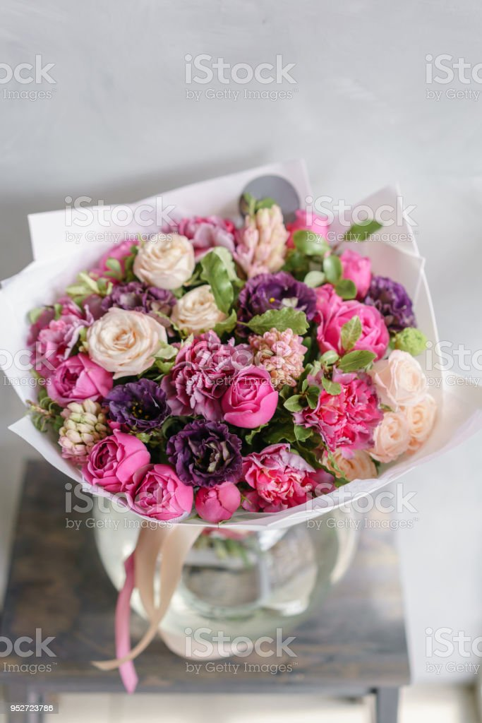 Purple And Pink Bouquet Of Beautiful Flowers On Wooden Table