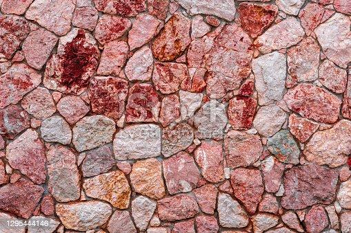 Purple and pink marble stone wall texture background. The texture of limestone or Closeup surface grunge stone texture, stonework rock old pattern clean grid uneven bricks design stack
