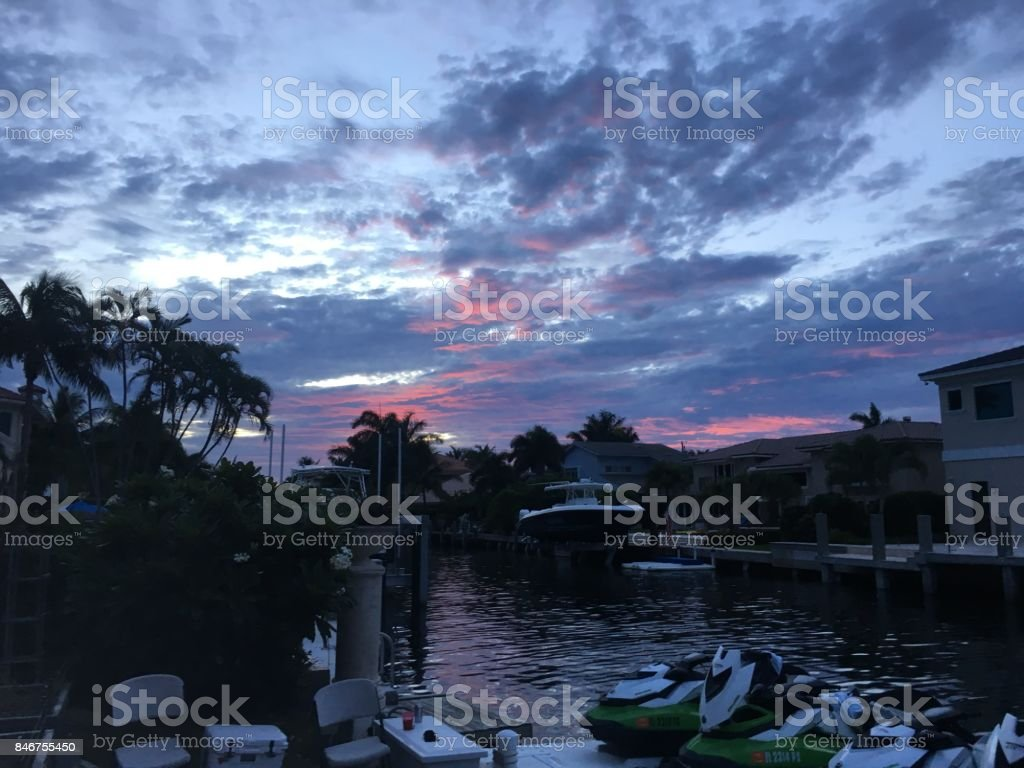 purple and pink sunset on the river stock photo