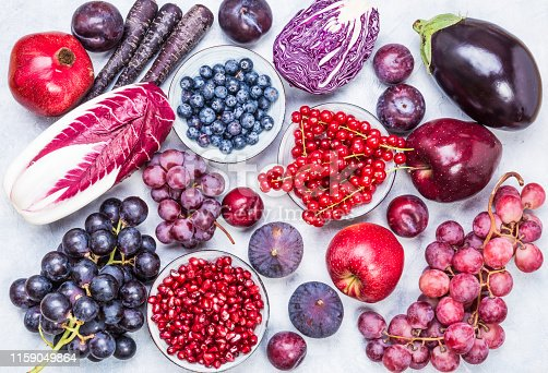 istock Purple and red color fruits and vegetables top view. 1159049864