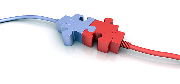 Purple and red cord connectors shaped like puzzle pieces stock photo