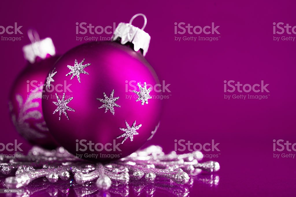 purple and silver christmas ornaments on dark purple xmas background royalty free stock photo