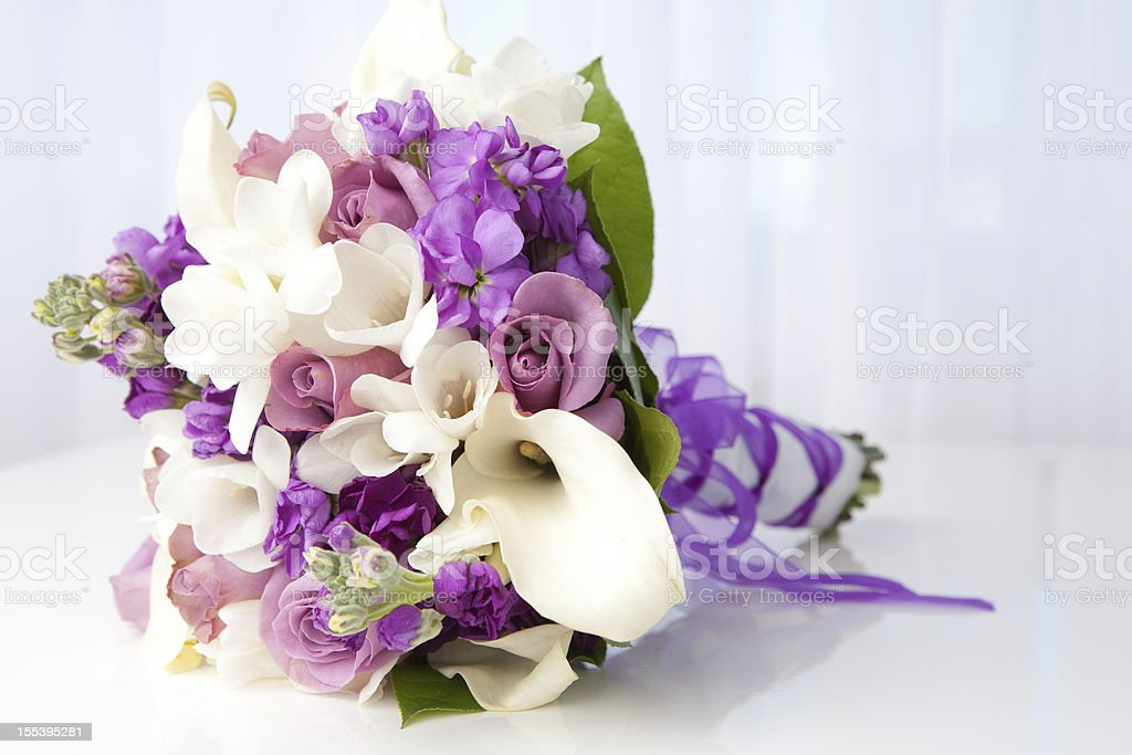 Purple and white bridal bouquet stock photo