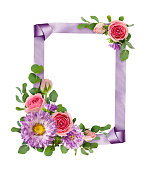 istock Purple asters and pink rose flowers with eucalyptus leaves in a corner arrangements with ribbon frame 928473104