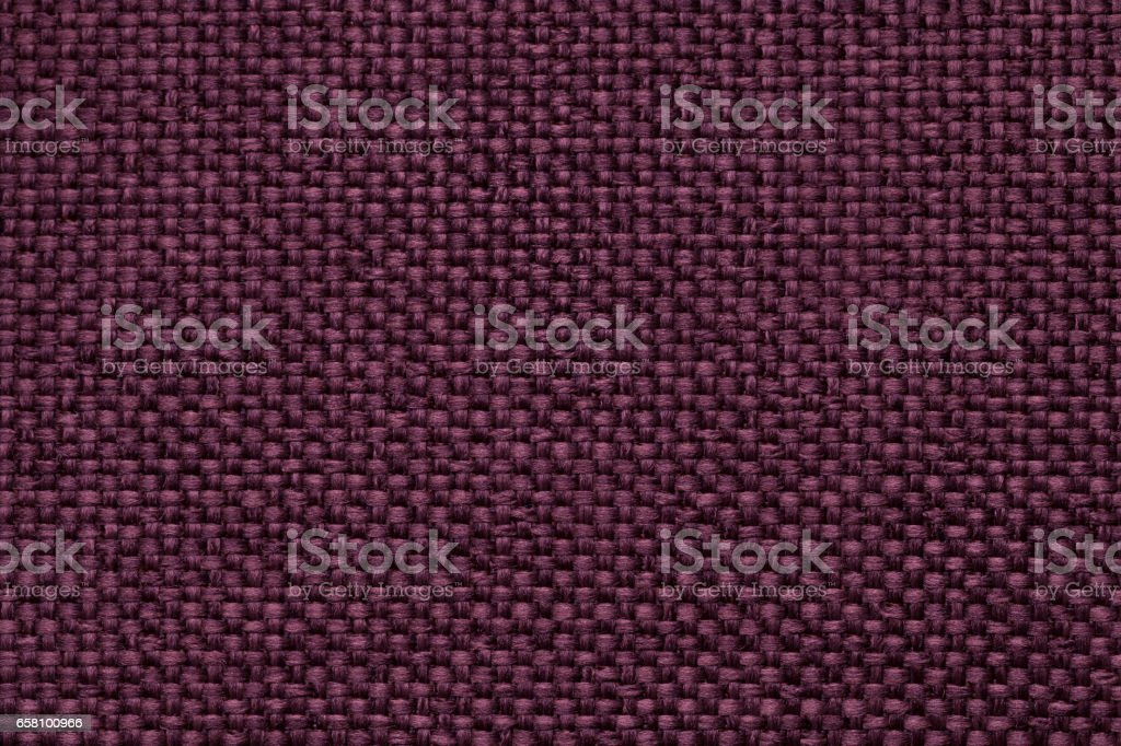 Purple background with braided checkered pattern, closeup. Texture of the weaving fabric, macro. royalty-free stock photo