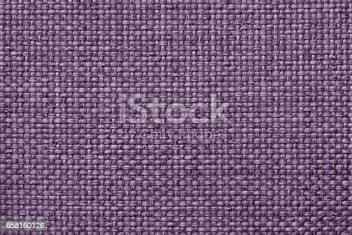 Light violet background with braided checkered pattern, closeup. Texture of the weaving fabric, macro.