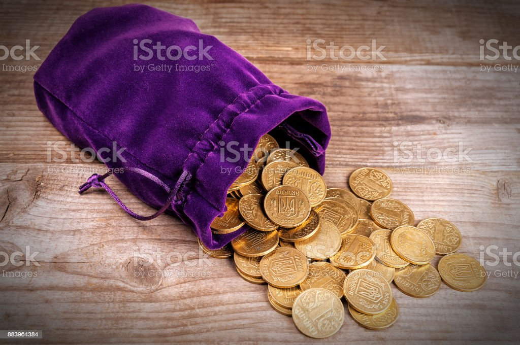 purple bag with coins stock photo