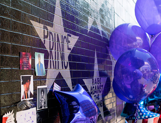 Purple balloons next to Prince star to honor is life stock photo