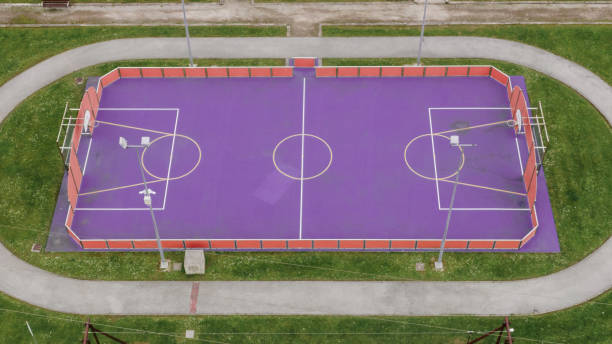 Purple basketball and soccer field stock photo