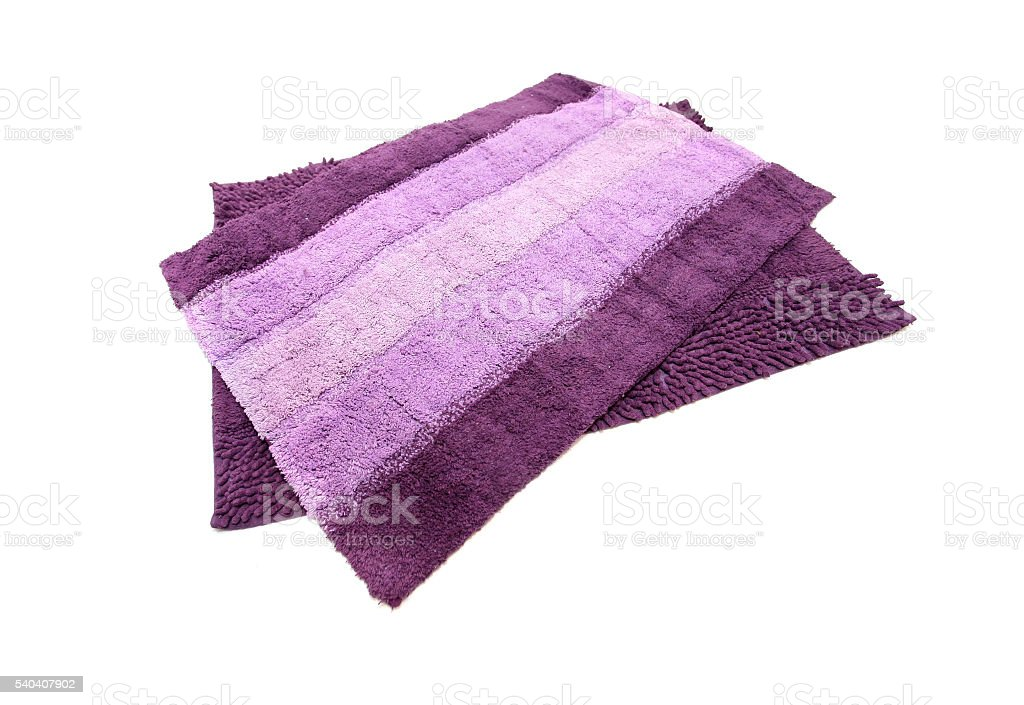 Purple bath mat stock photo