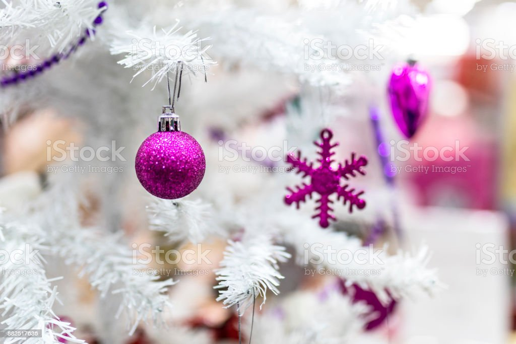 Purple Baubles And Decorations Hanging On A White Christmas Tree In