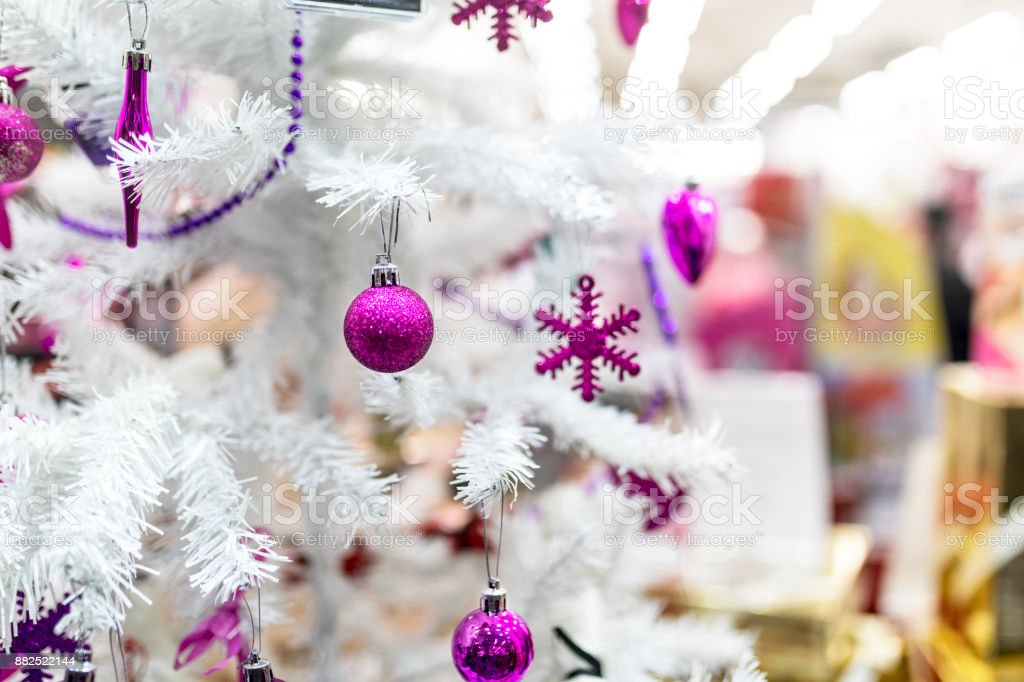 Purple Baubles And Decorations Hanging On A White Christmas Tree In The Shop Window Of A Mall Store In The Uk Stock Photo Download Image Now